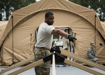 A Global Response Force lead trains his team on configuring tents, May 6, 2019 at Joint Base Langley-Eustis, Virginia.