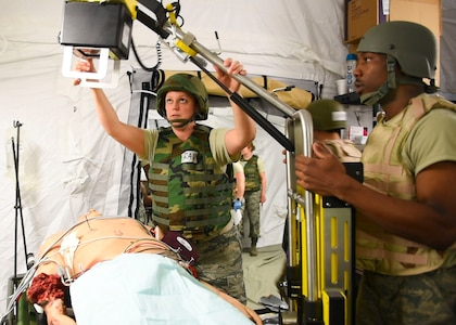 Players in the Expeditionary Medical Support exercise X-ray a mannequin May 9, 2019 at Joint Base Langley-Eustis, Virginia.