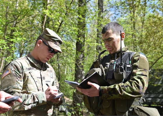 Army Capt. Timothy Reynolds, commander of the 290th Military Police Company, Maryland National Guard, speaks with 1st Lt. Mart Sildnik, company commander of 1st Infantry Brigade military police, Estonian Defense Force, during the Spring Storm exercise, May 6, 2019, in Ida-Viru County, Estonia. Spring Storm is an Estonian Defense Force annual exercise that fosters collaboration between Estonia, the United States, Poland, Britain, Canada and other participating allied nations.