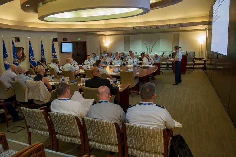U.S. Air Force Col. Jean Eisenhut, assigned to U.S. Air Force Space Command, gives a briefing during the Air Senior National Representatives meeting at Headquarters Pacific Air Forces, Joint Base Pearl Harbor-Hickam, Hawaii, May 9, 2019.