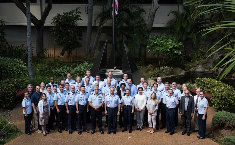 U.S. Air Force Airmen and members from the Royal Australian Air Force take a group photo at the Headquarters Pacific Air Forces building during the Air Senior National Representatives meeting at Joint Base Pearl Harbor-Hickam, Hawaii, May 10, 2019.