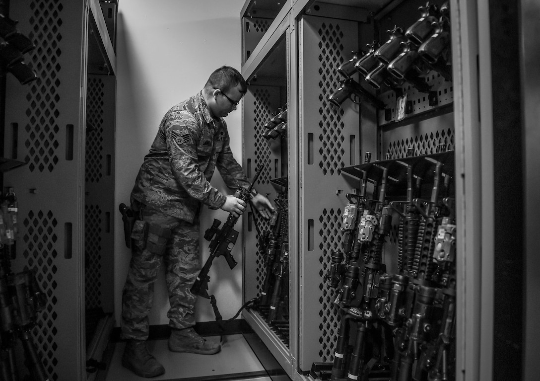 U.S. Air Force Senior Airman Cory Loicao, 627th Security Forces Squadron flight armorer, returns an M-16 rifle to the new armory rack system installed at the squadron's armory as a part of the Reconstitute Defender Initiative (RDI) at Joint Base Lewis-McChord, Wash., April 30, 2019. Air Force leaders declared 2019 the – Year of the Defender – and committed to implementing the RDI to provide better funding and opportunities to security forces squadrons throughout the Air Force.  (U.S. Air Force photo by Senior Airman Tryphena Mayhugh)