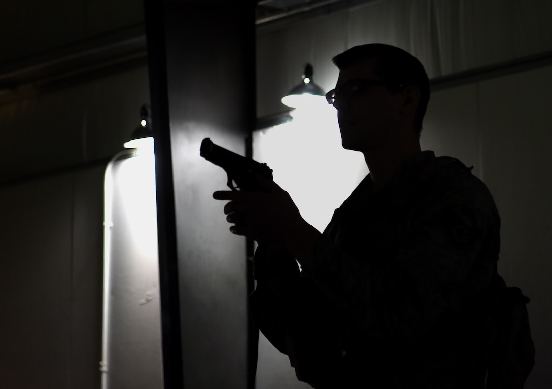 U.S. Air Force Staff Sgt. Chad Rogers, 627th Security Forces Squadron (SFS) noncommissioned officer in charge of plans and programs, removes his weapon during a simulated active-shooter training scenario at Joint Base Lewis-McChord, Wash., April 30, 2019.  Top Air Force leaders declared 2019 as the Year of the Defender, initiating the Reconstitute Defender Initiative to revitalize the security forces squadron across the Air Force. As a part of this, the 627th SFS has worked to increase their time using the U.S. Army's urban-response simulator for training. (U.S. Air Force photo by Senior Airman Tryphena Mayhugh)