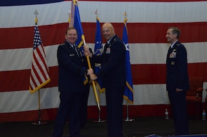 Maj. Gen. Brian K. Borgen receives the Tenth Air Force Flag from Lt. Gen. Richard Scobee, signifying accepts command of Tenth Air Force during the Change of Command ceremony May 10, at Naval Air Station Fort Worth Joint Reserve Base, Texas