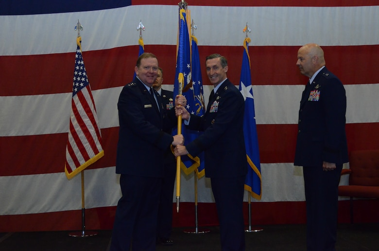 "Maj. Gen. Ronald B. ""Bruce"" Miller returns the flag to Lt. Gen. Richard W. Scobee, signifying the end of his time as Tenth Air Force Commander during the Tenth Air Force Change of Command ceremony, May 10, at Naval Air Station Fort Worth Joint Reserve Base, Texas"