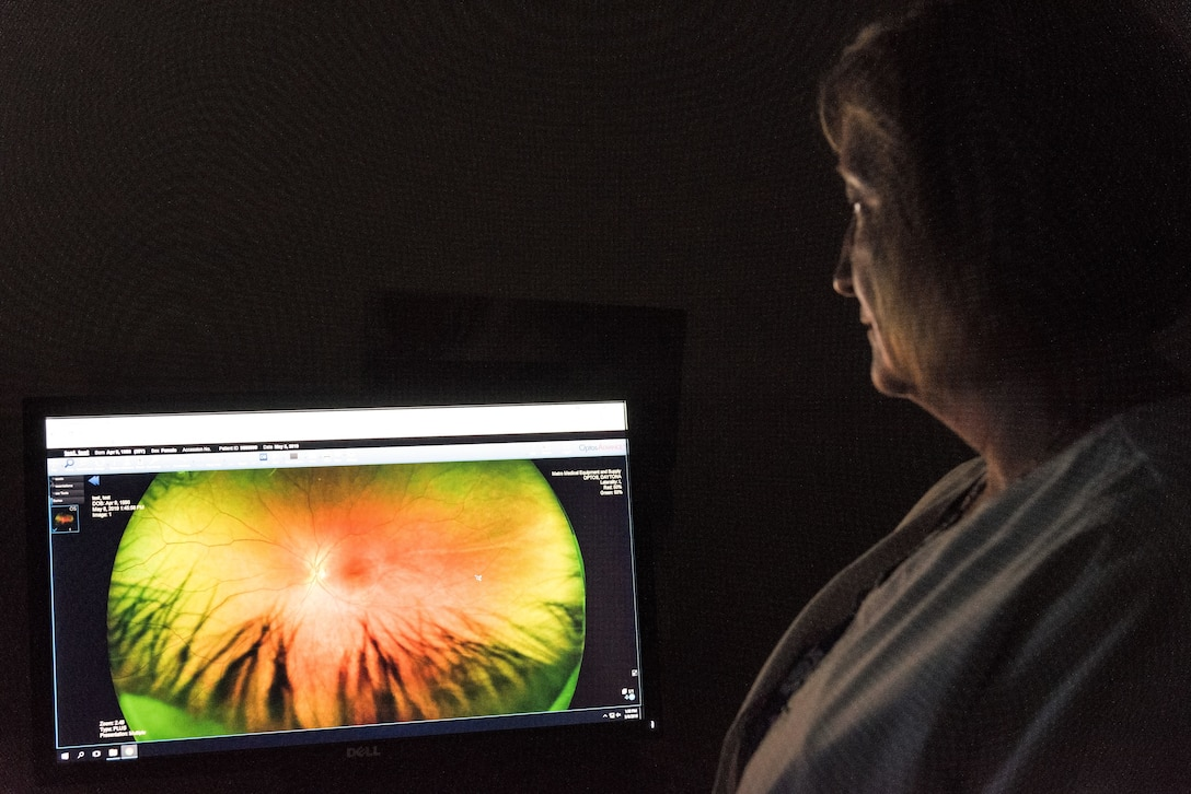 Jennifer Freeman, 436th Aerospace Medicine Squadron ophthalmic technician, views an image of a patient's eye captured during a retinal examination May 8, 2019, at the Optometry Clinic on Dover Air Force Base, Del. Captured images of each eye enable optometry personnel to inspect the optic nerve, blood vessels and retina. (U.S. Air Force photo by Roland Balik)