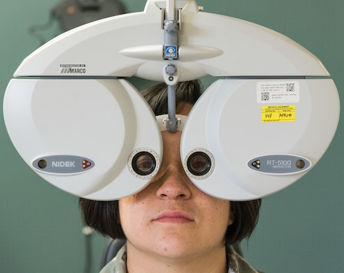 Staff Sgt. Courtney Herrera, 436th Medical Support Squadron radiologic technologist, receives a refraction test during her routine eye examination May 8, 2019, at the Optometry Clinic on Dover Air Force Base, Del. The refraction test allowed the optometrist to dial in the exact prescription needed by Herrera. (U.S. Air Force photo by Roland Balik)