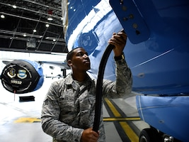 Senior Airman Bowles, 932nd Maintenance Group Fuels Shop, prepares to perform checks on air cabin pressure by first applying power connection to the C-40C aircraft on May 1, 2019, at Scott Air Force Base, Ill.  He and other 932nd Maintenance Group team members worked together to test pressure and get the plane ready for another mission.  The Citizen Airmen of the 932nd AW in Illinois come from more than 30 states to drill on Unit Training Assembly weekends.  (U.S. Air Force photo by Lt. Col. Stan Paregien)