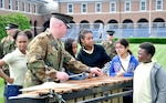 """Students from the John Tyler Elementary, located near the Marine Corps Barracks Washington, enjoyed a """"hands on,"""" morning visit to the Barracks to learn more about their mission and life of the Marines stationed in the DC area."""