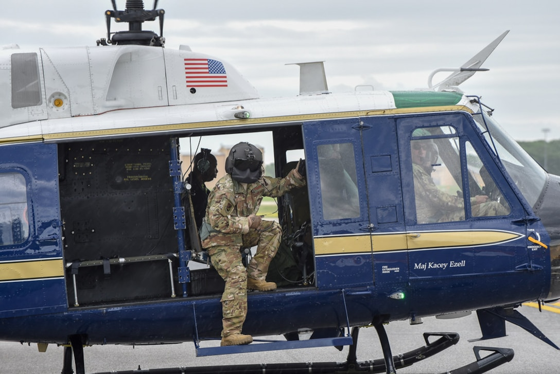 U.S. Air Force Technical Sgt. Joshua Lucas, 1st Helicopter Squadron flight engineer, prepares for flight in a UH-1 Huey during the opening ceremonies at the Joint Base Andrews Air & Space Expo, May 10. (U.S. Air Force photo by 2nd Lt. Jessica Cicchetto)