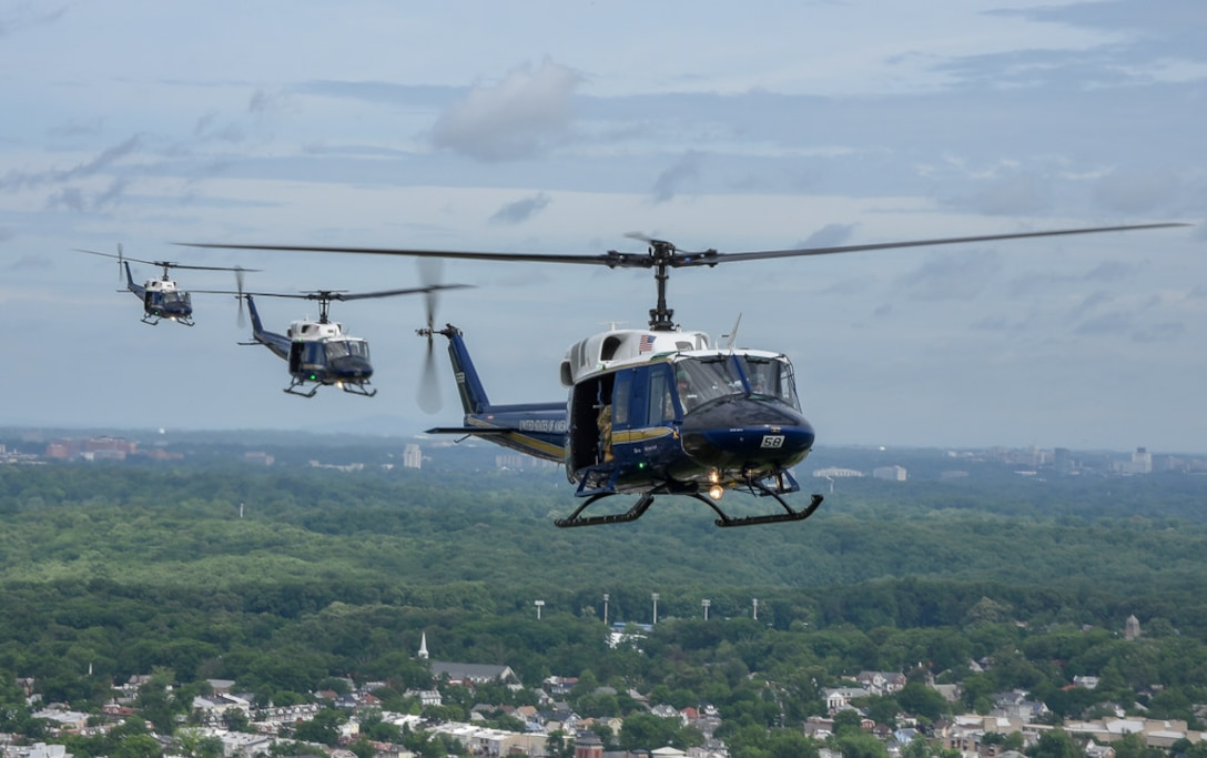 Members of the 1st Helicopter Squadron fly UH-1 Hueys over Washington during opening ceremonies of the Joint Base Andrews Air & Space Expo, May 10. (U.S. Air Force photo by 2nd Lt. Jessica Cicchetto)