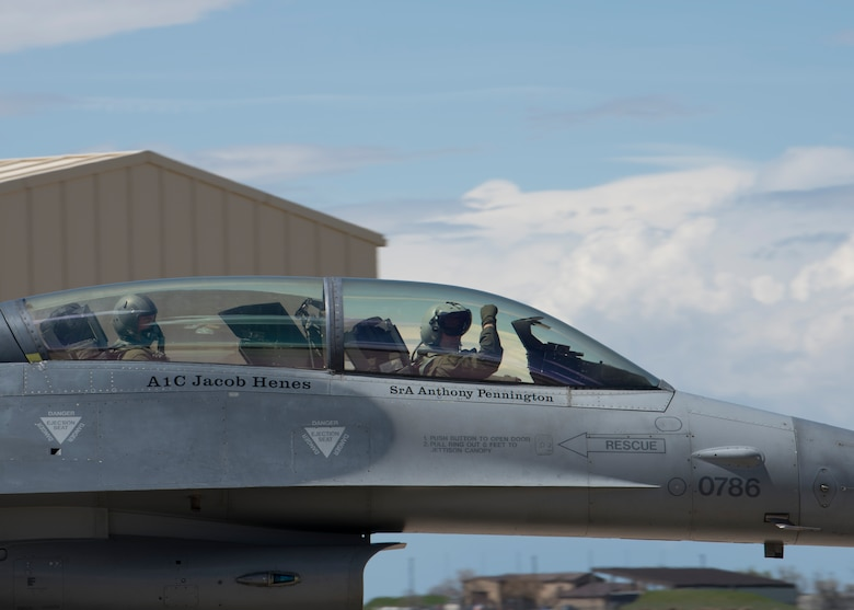 "A 311th Fighter Squadron F-16 Viper pilot displays the squadron ""Fangs Out"" symbol as he taxis before takeoff, April 24, 2019, on Hill Air Force Base, Utah. Between April 22 and May 3, the 311th FS conducted 174 sorties in support of student pilot training and dissimilar air combat training with the F-35 Lightning II. (U.S. Air Force photo by Staff Sgt. BreeAnn Sachs)"