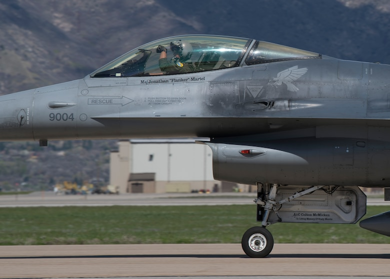 "A 311th Fighter Squadron F-16 Viper pilot displays the squadron ""Fangs Out"" symbol while taxiing after takeoff, April 24, 2019, on Hill Air Force Base, Utah. Between April 22 and May 3, the 311th FS conducted 174 sorties in support of student pilot training and dissimilar air combat training with the F-35 Lightning II. (U.S. Air Force photo by Staff Sgt. BreeAnn Sachs)"