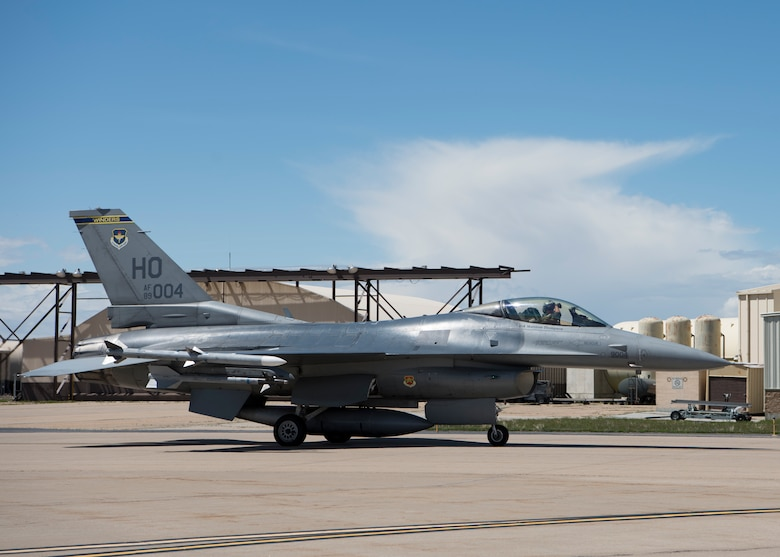 "A 311th Viper F-16 Viper pilot displays the squadron ""Fangs Out"" symbol while taxiing, April 24, 2019, on Hill Air Force Base, Utah. The 311th FS brought 16 F-16 D-models to provide Familiarization Flights to 40 operations and maintenance personnel during exercise Viper Venom 19-01. (U.S. Air Force photo by Staff Sgt. BreeAnn Sachs)"