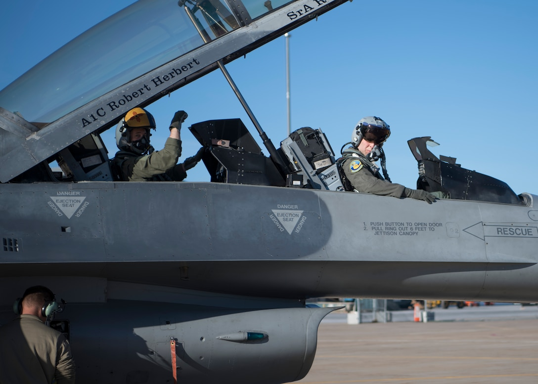 "An Airman displays the 311th Fighter Squadron ""Fangs Out"" symbol before a familiarization flight, April 25, 2019, on Hill Air Force Base, Utah. Forty operations and maintenance personnel were given FAM flights during exercise Venom 19-01. (U.S. Air Force photo by Staff Sgt. BreeAnn Sachs)"