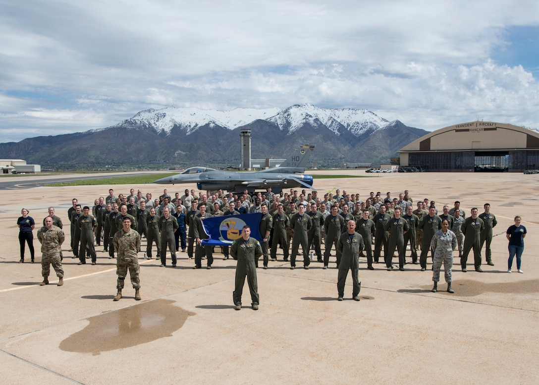 Members of the 311th Fighter Squadron pose for a squadron photo, April 25, 2019, on Hill Air Force Base, Utah. Between April 22 and May 3, the 311th FS conducted 174 sorties in support of student pilot training and dissimilar air combat training with the F-35 Lightning II. (U.S. Air Force photo by Staff Sgt. BreeAnn Sachs)