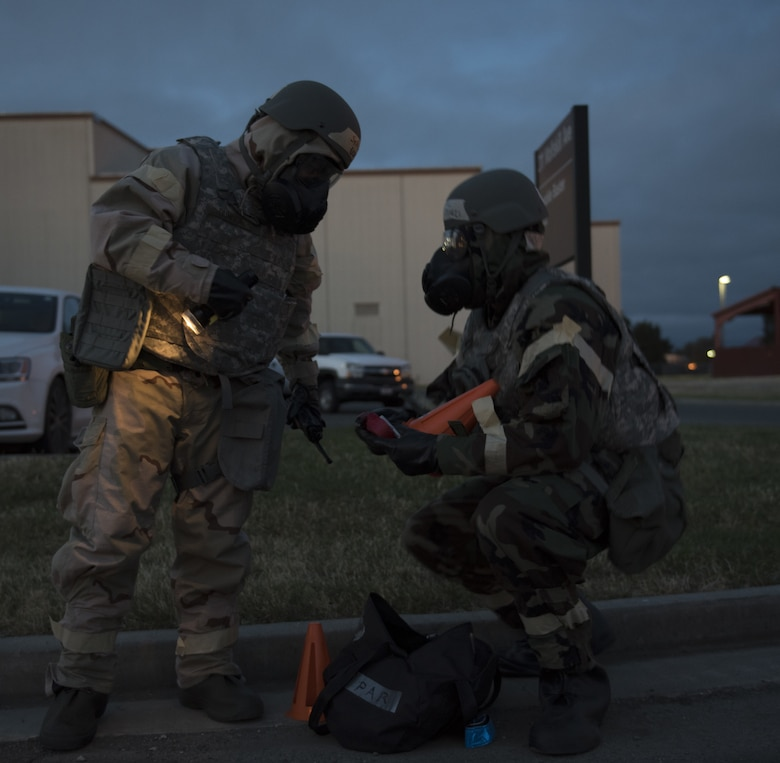 U.S. Air Force Senior Airman Charles Dungca, left, and Airman 1st Class Kelvin Powell, right, 60th Medical Group bioenvironmental specialists, perform a post attack reconnaissance sweep May 7, 2019, during a readiness exercise at Travis Air Force Base, California. The base conducted a week-long exercise to evaluate Travis' ability to execute and sustain rapid global mobility operations. (U.S. Air Force photo by Staff Sgt. Amber Carter)