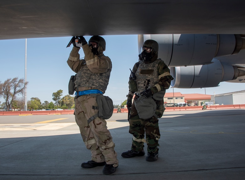 U.S. Air Force Staff Sgt. Corey Fugate, left, and SSgt. Christopher Renteria, right, both with the 349th Aircraft Maintenance Squadron, preform liquid oxygen service on a C-5M Super Galaxy during a readiness exercise at Travis Air Force Base, California, May 9, 2019. The base conducted a week-long exercise that evaluated Travis' readiness and ability to execute and sustain rapid global mobility around the world. (U.S. Air Force photo by Heide Couch)