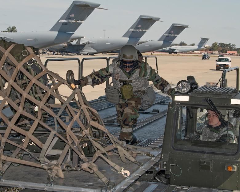 U.S. Air Force Airmen assigned to the 60th Aerial Port Squadron perform a cargo load during a readiness exercise at Travis Air Force Base, California, May 7, 2019. The base conducted a week-long exercise that evaluated Travis' readiness and ability to execute and sustain rapid global mobility around the world. (U.S. Air Force photo by Louis Briscese)