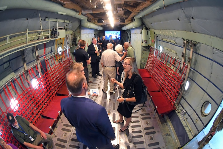 "Guests tour the ""The C-130 Experience"" located inside the Hill Aerospace Museum May 14, 2019, at Hill Air Force Base, Utah. The museum worked with base and community partners for several years to convert the C-130 aircraft fuselage into an interactive classroom. Visitors can now sit in the pilot's seat, push buttons, flip switches and turn the dials. The complete experience will include all of the sights, sounds and smells of a real C-130 mission. (U.S. Air Force photo by Todd Cromar)"
