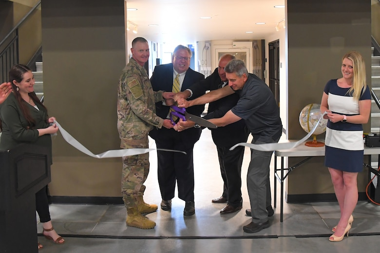 "Officials cut a ribbon during a ceremony to mark the opening of the ""The C-130 Experience"" inside the Hill Aerospace Museum May 14, 2019, at Hill Air Force Base, Utah. The museum worked with base and community partners for several years to convert the C-130 aircraft fuselage into an interactive classroom. The major focus of the learning center curriculum will include the history of the aircraft, beginning in the 1960s through present day, and the important part it's played in the Air Force and in the defense of the country.  (U.S. Air Force photo by Todd Cromar)"