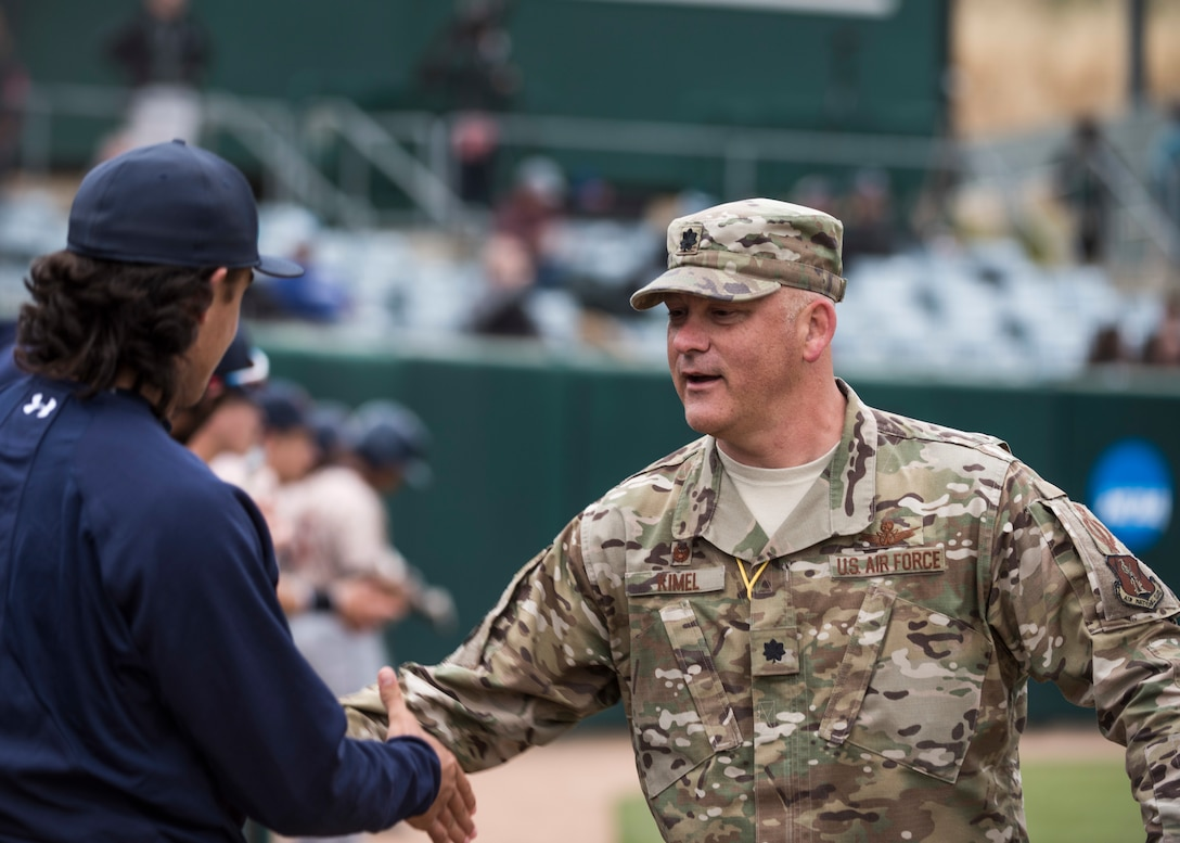 Lt. Col. Steven Kimel, 216th Space Control Squadron commander, greets members of the California Polytechnic State University Hero's Night baseball team May 7, 2019, at the Alex G. Spanos Stadium at in San Luis Obispo, Calif. Kimel was invited to throw the first pitch during Hero's Night as a way for the community to show appreciation to their local heroes. (U.S. Air Force photo by Airman 1st Class Aubree Milks)