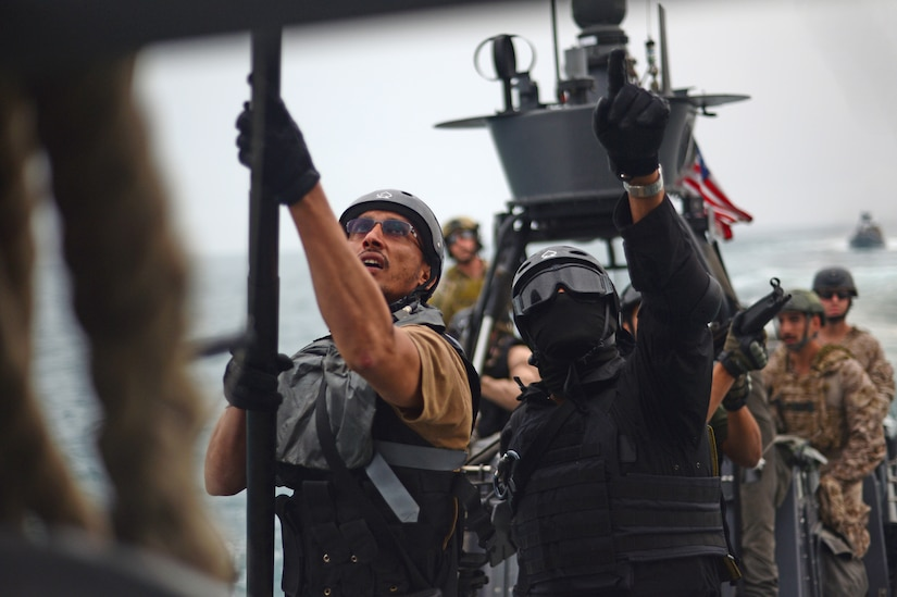 "Special forces from Gulf Cooperation Council nation attempt to hook boarding ladder onto U.S. Army vessel ""Corinth"" during visit, board, search, and seizure training in Arabian Gulf during exercise Eagle Resolve, March 17, 2015 (U.S. Air Force/Kathryn L. Lozier)"