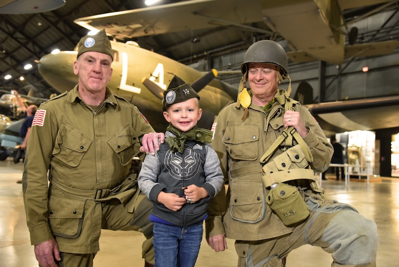 WWII Paratrooper reenactors pose with museum visitors at the National Museum of the USAF on May, 13, 2019.
