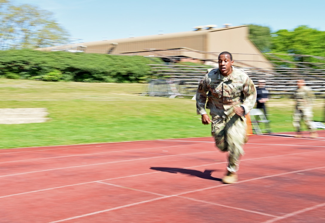 "U.S. Air Force Chief Master Sgt. Micah Small, 100th Security Forces Squadron superintendent, sprints during the 48th Security Forces Squadron's ""Spartan Race,"" which is a part of National Police Week at RAF Lakenheath, England, May 14, 2019. National Police Week is a chance for all law enforcement officials to pay respects to the officers who came before them, and also gives the base community the opportunity to support the force as well. (U.S. Air Force photo by Airman 1st Class Brandon Esau)"