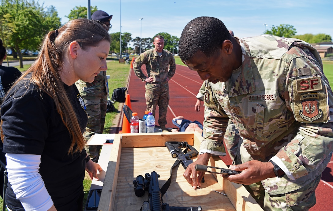 "U.S. Air Force Chief Master Sgt. Micah Small, 100th Security Forces Squadron superintendent, assembles an M-4 during the 48th Security Forces Squadron's ""Spartan Race"" at RAF Lakenheath, England, May 14, 2019. The ""Spartan Race"" is part of the week-long National Police Week recognition, in which both squadrons held events May 13-17. (U.S. Air Force photo by Airman 1st Class Brandon Esau)"