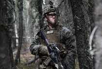 U.S. Marine Corps Cpl. Johnathan Scott, an infantry Marine with 2nd Battalion, 7th Marine Regiment, Special Purpose Marine Air Ground Task Force 7, conducts military operations on urbanized terrain training during exercise Northern Edge, May 13, 2019, at Fort Greely, Alaska. Approximately 10,000 U.S. military personnel will participate in exercise NE 2019, a joint training exercise hosted by U.S. Pacific Air Forces that prepares joint forces to respond to crises in the Indo-Pacific region.