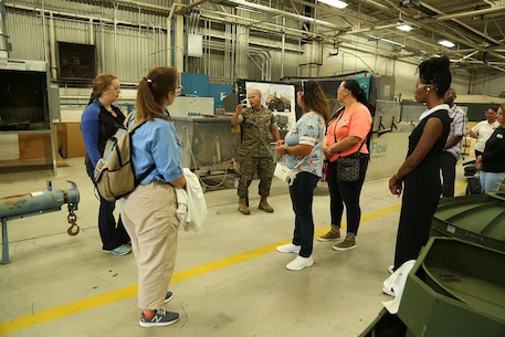 Several spouses participate in Marine Corps Logistics Command's first Mission Overview Course for Spouses at the Town and Country Ballroom aboard Marine Corps Logistics Base Albany, May 1.   The course consisted of a command brief, team building activity and tours of Marine Depot Maintenance Command and Marine Force Storage Command.