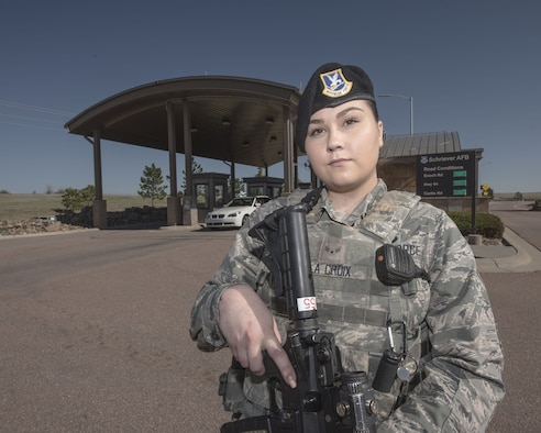 Airman 1st Class Stevie La Croix, 50th Security Force Squadron response force patrol, stands guard at the North Gate at Schriever Air Force Base, Colorado, May 15, 2019. Defenders like La Croix can be found at various posts across the installation as part of a security unit, conducting building checks or verifying credentials at any of the entry control points and checking traffic on the installation. (U.S. Air Force photo by Staff Sgt. Matthew Coleman-Foster)