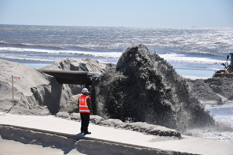 USACE personnel inspects sand discharge at East Rockaway Inlet Dredging Project.