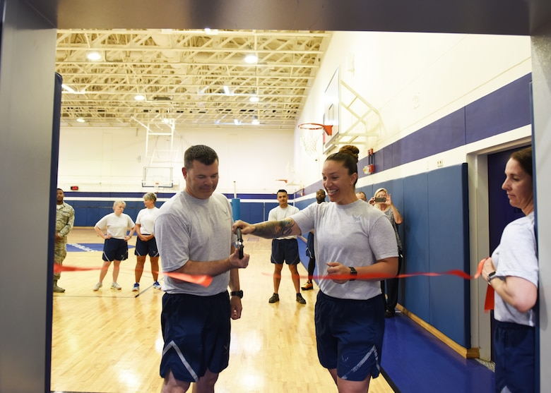 Col. Brian Filler, 39th Air Base Wing vice commander (left), and Tech. Sgt. Elizabeth Corpus, 39th ABW command section NCO in charge, conduct a ribbon-cutting ceremony at the Larger than Life Fitness Center on May 15, 2019, at Incirlik Air Base, Turkey. Through the combined efforts of the command staff, Force Support Squadron, and Civil Engineer Squadron, the fitness center underwent a 47-day renovation focused on accommodating specific physical fitness requirements of battlefield Airmen. (U.S. Air Force photo by Senior Airman Joshua Magbanua)