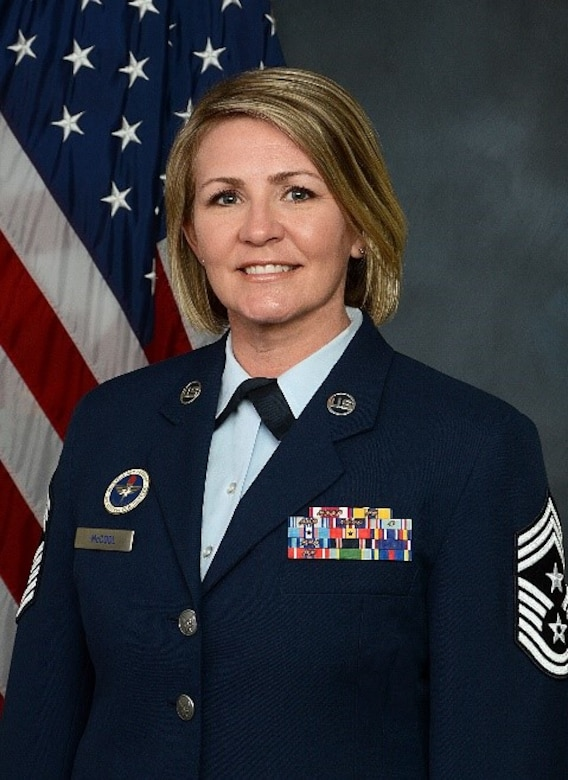 Chief Master Sergeant Kathleen M. McCool is the Command Chief Master Sergeant, 509th Bomb Wing, Whiteman Air Force Base, Missouri. She is the principle advisor to the Wing Commander and staff on mission effectiveness, professional development, military readiness, training, utilization, health, morale, and welfare of the command's 3,900 enlisted Airmen.