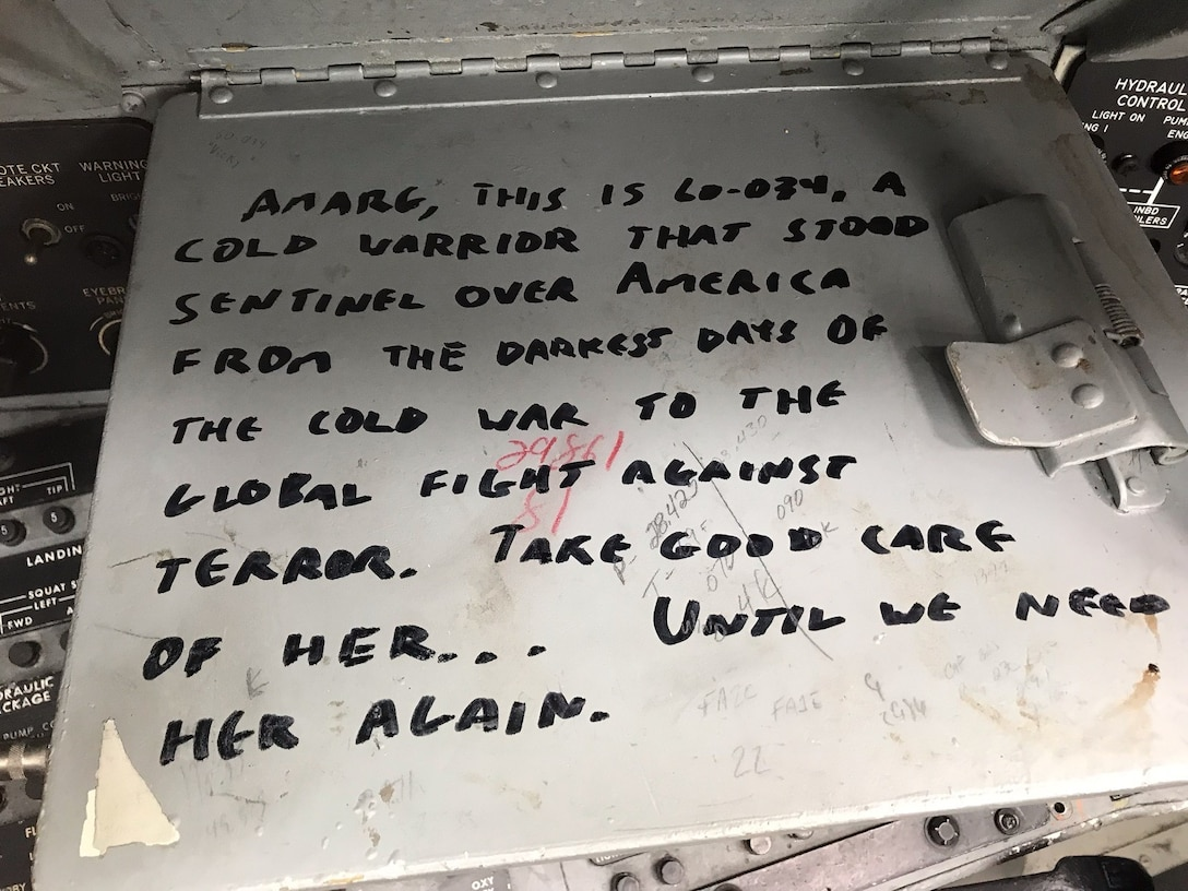 A note found inside the cockpit of Wise Guy, a B-52 Stratofortress, is displayed at Davis-Monthan Air Force Base, Arizona.  The jet has been a the 309th Aerospace Maintenance and Regeneration Group since 2008 and was recently flow out to be restored to active service. (courtesy photo)