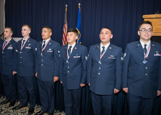 """Team Dover Airmen sing the Air Force song, """"Wild Blue Yonder,"""" at the conclusion of an Airman Leadership School graduation ceremony May 2, 2019, at Dover Air Force Base, Del. The school is a requirement for promotion into the noncommissioned officer ranks. (Official U.S. Air Force photo by Mauricio Campino)"""