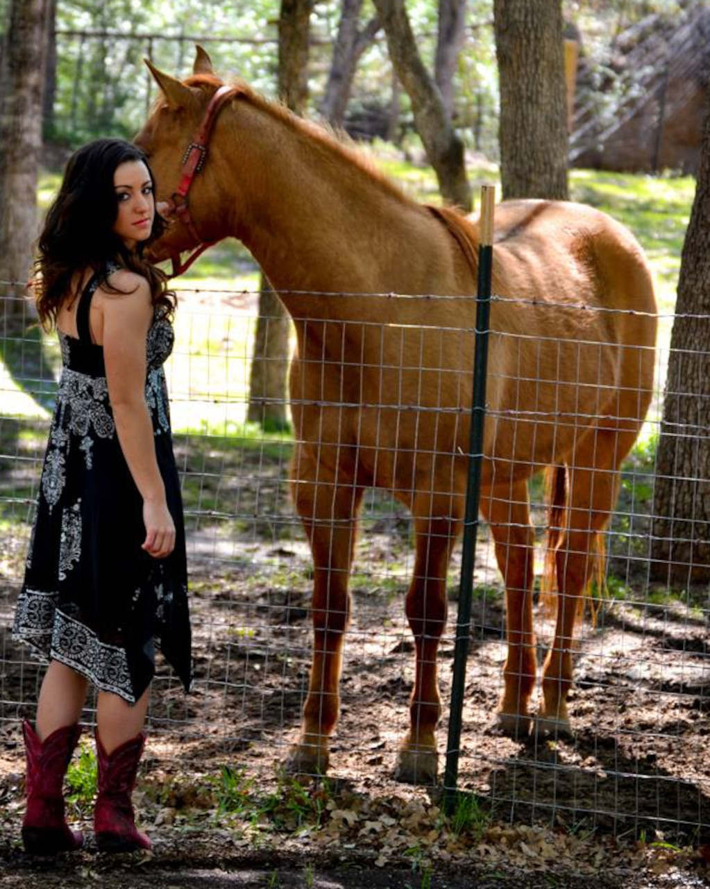 Woman poses with her horse.