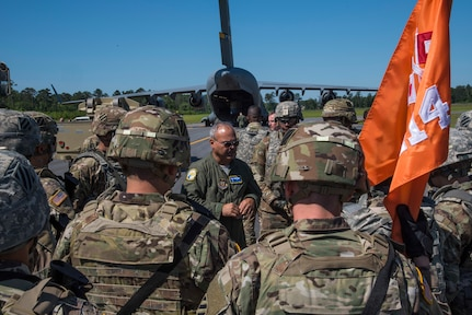 U. S. Air Force Tech. Sgt. Albert Pempsell, loadmaster with the 300th Airlift Squadron Joint Base Charleston, S.C., briefs Soldiers from the 414th Signal Company, Fort Stewart, Georgia, May 14, 2019, at Wright Army Airfield. The Airforce and the Army participated in an Expeditionary Deployment Readiness Exercise to help bolster combat readiness. (U.S. Air Force photo by Senior Airman William Brugge)
