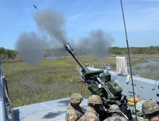 Virginia National Guard Soldiers assigned to the Norfolk-based 1st Battalion, 111th Field Artillery Regiment, 116th Infantry Brigade Combat Team conduct waterborne artillery live fire exercises during Operation GATOR April 24-25, 2019, at Camp Lejeune, North Carolina.