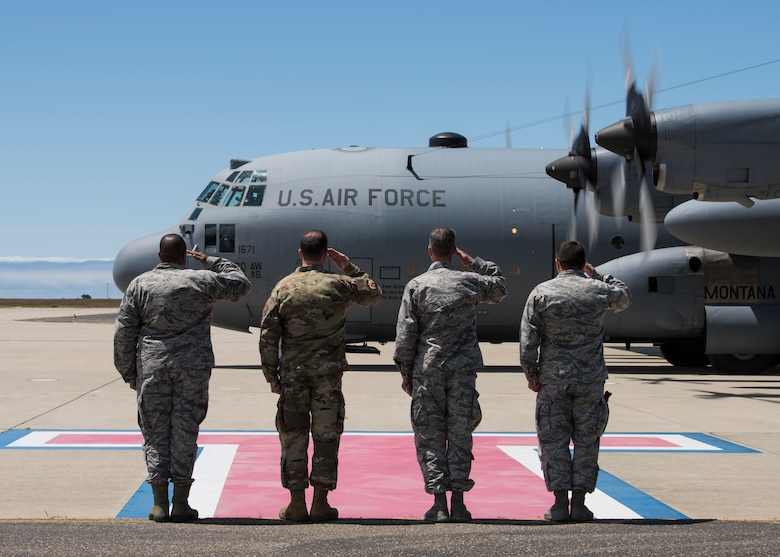 From right to left, Brig. Gen. Wolfe Davidson, 14th Air Force vice commander, Col. Michael Hunsberger, 30th Mission Support Group commander, Col. David Kelley, 576th Flight Test Squadron commander and Chief Master Sgt. Raymond Riley, acting 30th Space Wing command chief, salute a C-130 Hercules transporting the Chief of Staff of the Air Force civic leaders May 7, 2019, at Vandenberg Air Force Base, Calif. The CSAF civic leaders met with key agencies during their two day visit at Vandenberg AFB to gain an in-depth understanding of Air Force Minuteman III test launch capabilities. (U.S. Air Force photo by Airman 1st Class Aubree Milks)