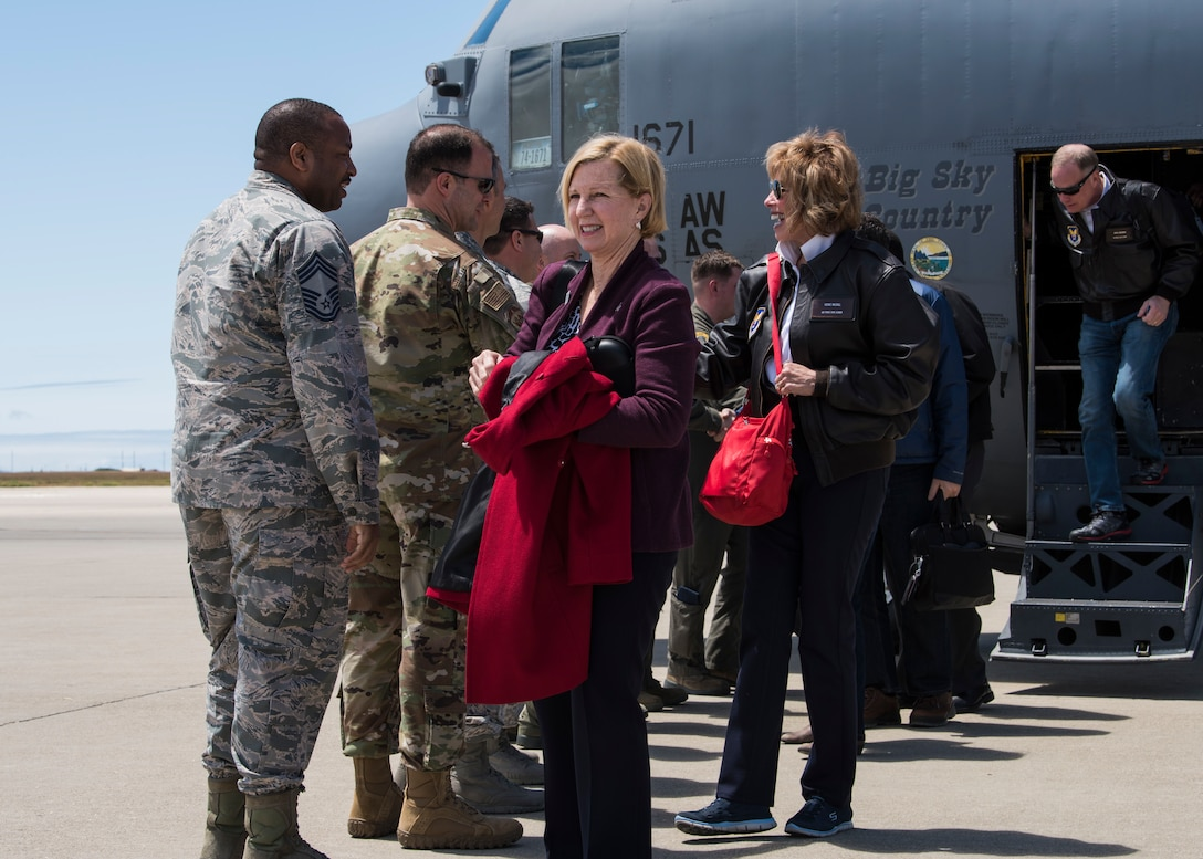Members of base leadership greet Pam Younker and Vickie McCall, Chief of Staff of the Air Force civic leaders, upon their arrival May 7, 2019, at Vandenberg Air Force Base, Calif. The CSAF civic leaders were transported from Malmstrom AFB to Vandenberg AFB as part of a four-day immersion tour to gain an in-depth understanding of space partnerships and Minuteman III modernization. (U.S. Air Force photo by Airman 1st Class Aubree Milks)