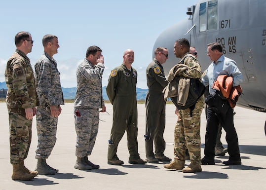 Brig. Gen. Wolfe Davidson, 14th Air Force vice commander, greets Chief of Staff of the Air Force civic leaders upon their arrival May 7, 2019 at Vandenberg Air Force Base, Calif. The CSAF civic Leaders visited Vandenberg AFB as part of a four day tour to learn about Air Force's space launch and Intercontinental Ballistic Missile missions. (U.S. Air Force photo by Airman 1st Class Aubree Milks)