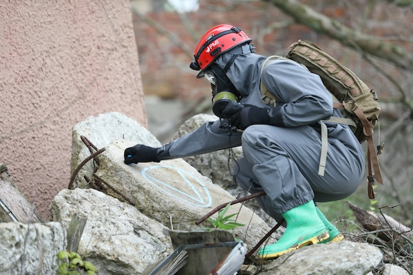A U.S. Army Soldier of the 2nd Platoon, 68th Engineer Construction Co., based in Fort Hood, Tex., conducts simulated, urban search and rescue operations in an area with a chemical, biological, radiological or nuclear contamination in Muscatacuck Urban Training Center, Ind., May 4, 2019. Guardian Response 19 is a joint, multi-component training exercise controlled by the U.S. Army Reserve 78th Training Division and includes more than 9,000 service members from across the country. The exercise tests the ability of the U.S. military to respond to a chemical, biological, radiological, or nuclear catastrophe as part of the Defense Support of Civil Authorities (DSCA) program. Under the DSCA program, the Department of Defense provides essential support to civil authorities for domestic emergencies. (U.S. Army Reserve Photo by Sgt. Phillip Scaringi/released)