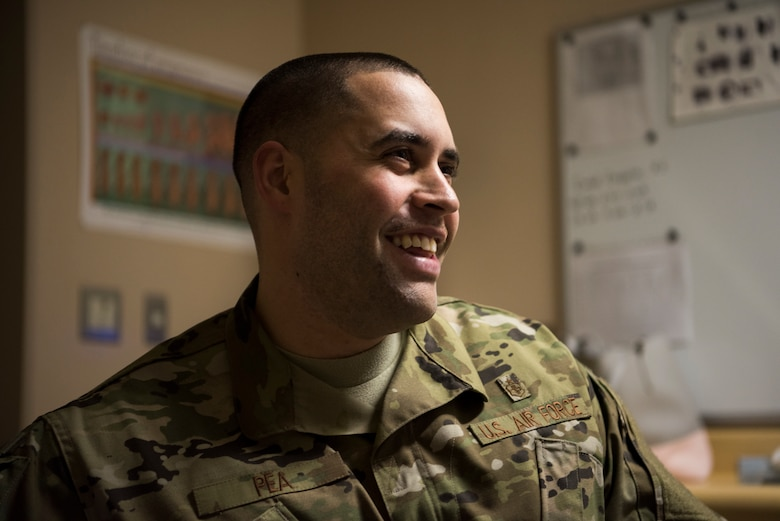 U.S. Air Force Staff Sgt. Nance Pea, the 35th Surgical Operations Squadron ultrasound NCO in charge, smiles while interacting with a patient at Misawa Air Base, Japan, April 10, 2019. Radiology technologists use diagnostic imaging, x-ray examinations, magnetic resonance imaging scans and computed tomography scans to care for patients and provide doctors with vital images that detect potential medical concerns. (U.S. Air Force photo by Senior Airman Collette Brooks)