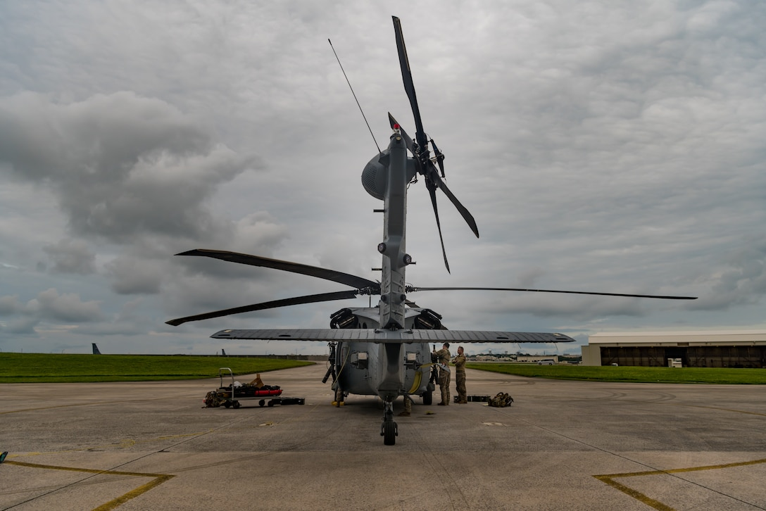 U.S. Air Force Tech. Sgt. Travis Kidwell, 33rd Rescue Squadron special mission aviator, prepares the gun aircraft unit on an HH-60G Pave Hawk during pre-flight inspections May 8, 2019, on Kadena Air Base, Japan.