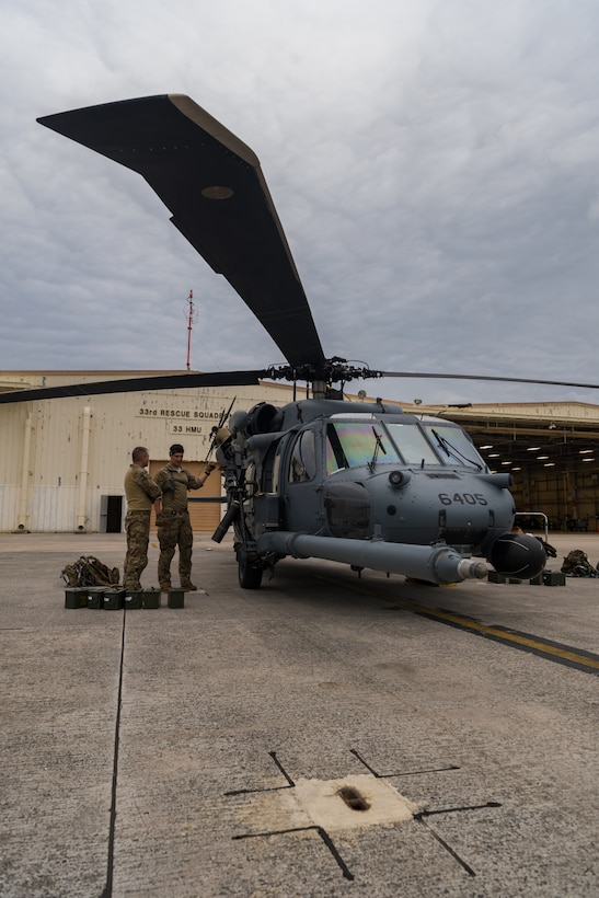 U.S. Air Force Tech. Sgt. Travis Kidwell, 33rd Rescue Squadron special mission aviator, performs pre-flight inspections on an HH-60G Pave Hawk May 8, 2019, on Kadena Air Base, Japan.