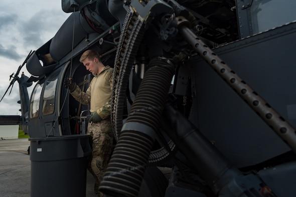 U.S. Air Force Maj. Margaret McCord, 33rd Rescue Squadron flight lead, performs avionics system checks on an HH-60G Pave Hawk May 8, 2019, on Kadena Air Base, Japan.