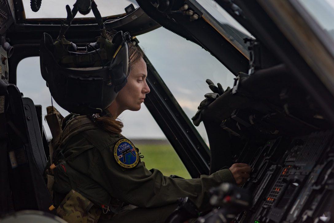 U.S. Air Force Maj. Margaret McCord, 33rd Rescue Squadron flight lead, performs avionics system checks on an HH-60G Pave Hawk May 8, 2019, on Kadena Air Base, Japan.